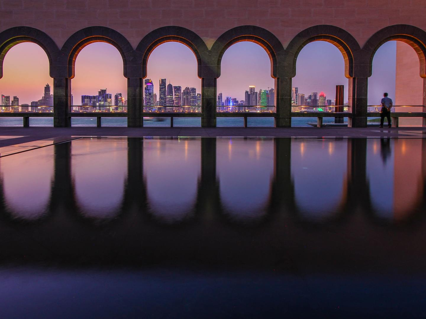 Skyline of Doha, Qatar during blue hour at the Museum of Islamic Art