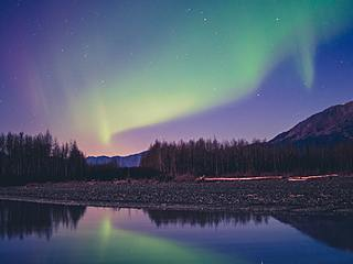 Northern lights in the sky over a lake in Portage