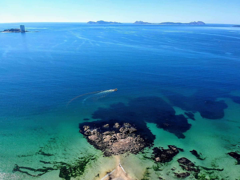 Rocky islands in clear waters as seen from above near Vigo, Spain